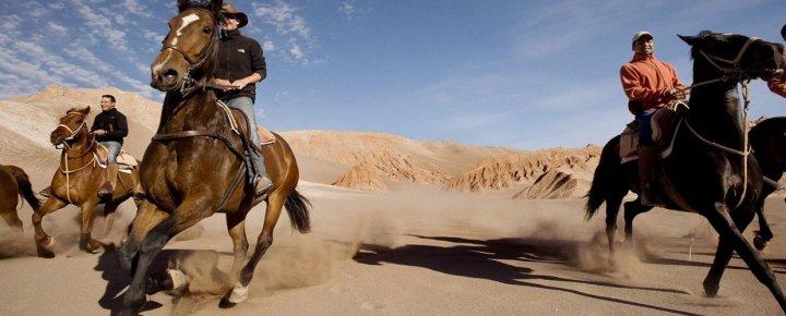 Explorers-riding-in-the-sandy-Atacama-DesertChile.-Adventure-travel-mh5p77ls47p4vsjhvrqabwezrpykluflds6yt82g08