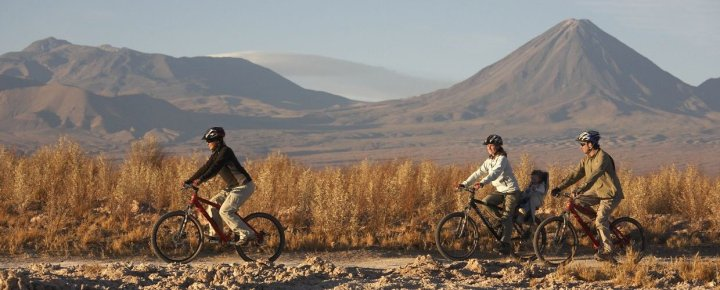 Explorers-riding-mountain-bikes-in-the-Atacama-Desert-Chile.-Camping-mh5p9ek82ap7z1ct2puy5chpo35ekf51omzr4gtdhk
